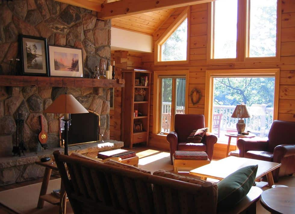 Photo of a sun-drenched living room in a Confederation Log Home