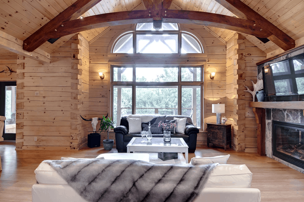 Decorative timber frame - a gorgeous enhancement in this Confederation Log & Timber Frame home