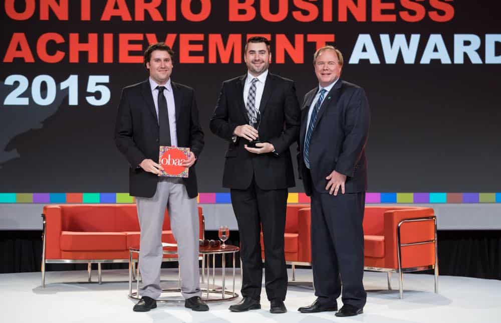 Rich and Andy Kinsman receive the Ontario Chamber of Commerce Sustainability award for Confederation's environmental commitment